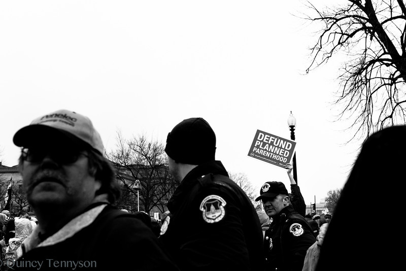 A protester at the March for Life 2012 lifts their sign high above the crowd as the march makes it's way to the front of the Senate building.